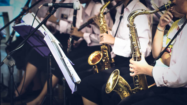 trumpeter plays her trumpet in the band stock photo