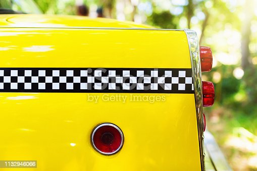 Trunk and tail lights of a 1950's New York checkered cab.
