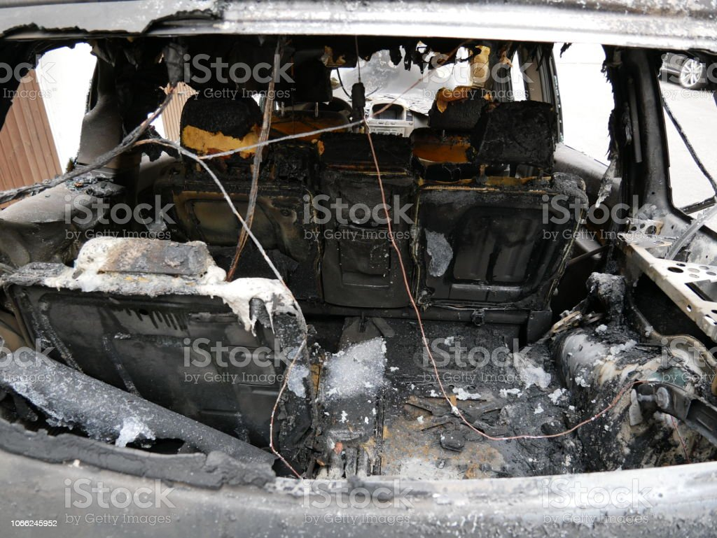 Trunk of a burnt down car from the rear window