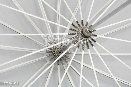 Truss of an open umbrella, black and white. Fibreglass rods.