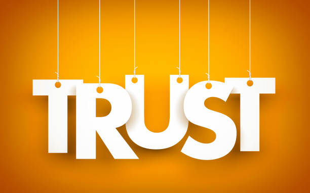 Trust - mot accroché sur fond orange. illustration 3D - Photo