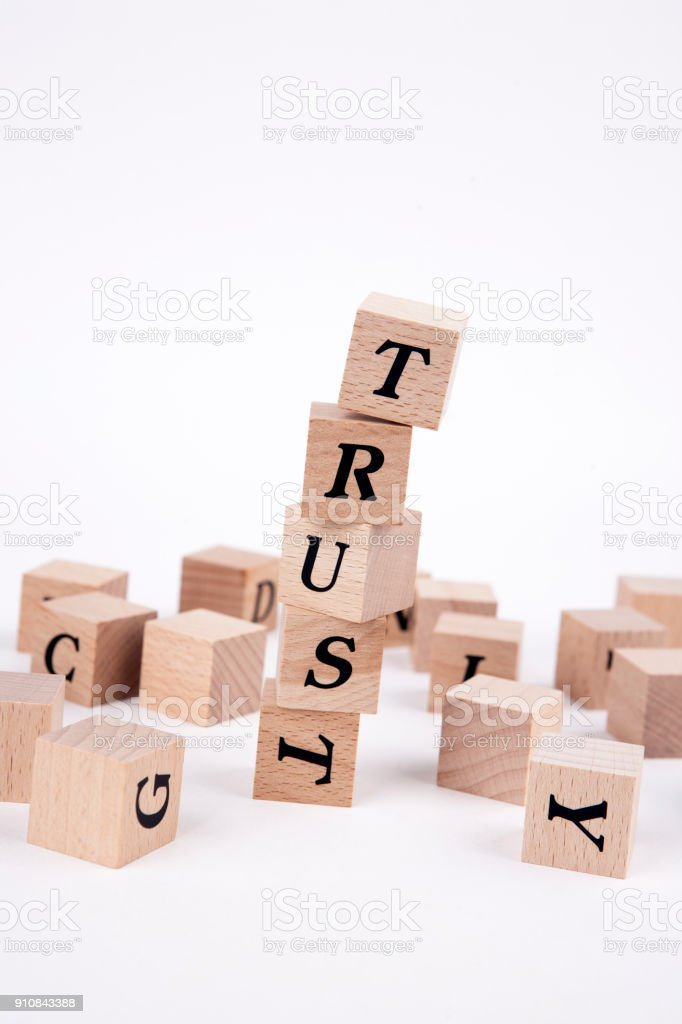 trust word written in wooden cubes tower stock photo