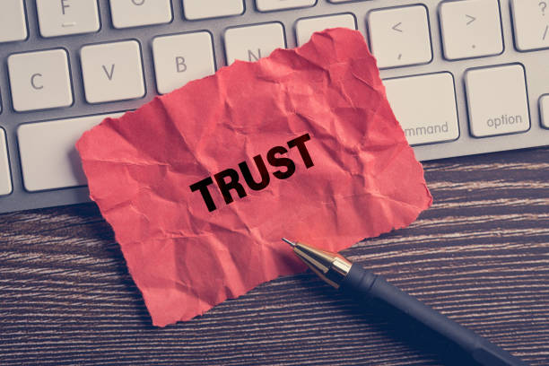 Trust written in the paper with office stock photo