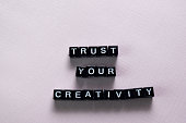Trust your creativity on wooden blocks. Motivation and inspiration concept