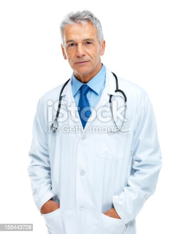 Portrait of confident senior medical doctor standing with hands in pockets isolated on white background