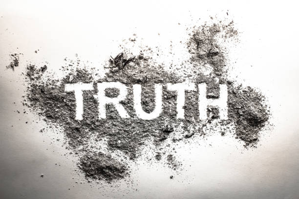 truth word written in grey ash, dust, dirt or filth as a cynical concept - disingenuous stock pictures, royalty-free photos & images