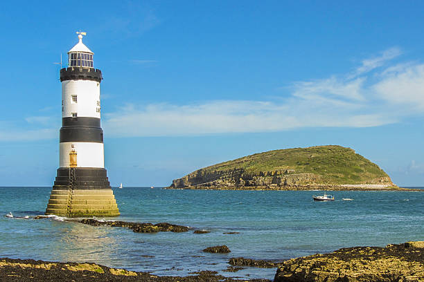 Trwyn Du Lighthouse and Puffin Island stock photo