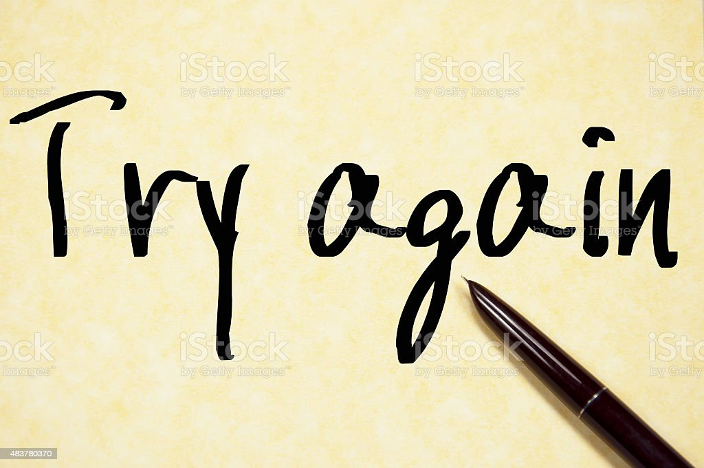 try again text write on paper stock photo