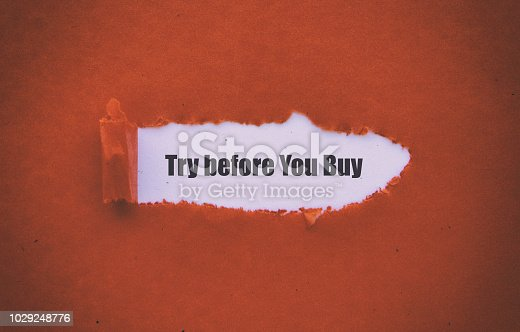 Try before You Buy written under torn paper.