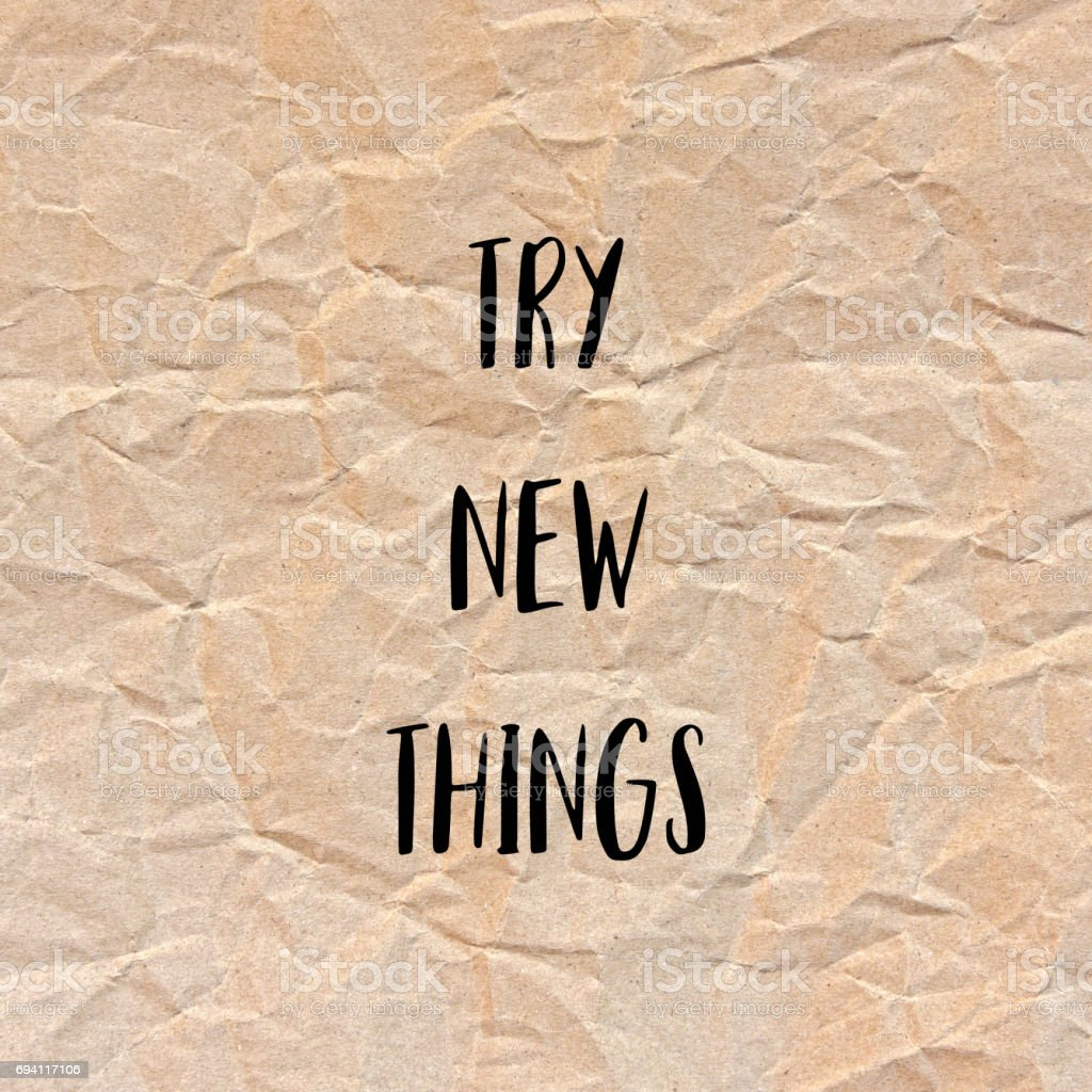 Try new things on brown crumpled paper stock photo