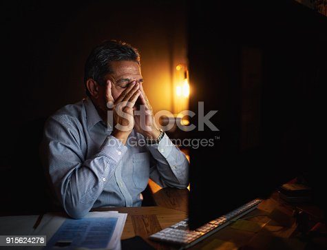 istock Trying his best not to let the deadlines defeat him 915624278