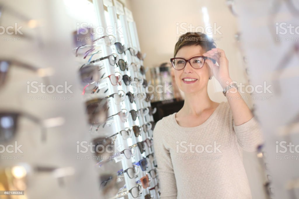 Trying new eyewear stock photo