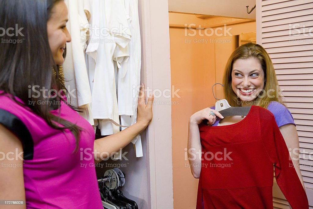 Trying on clothes while shopping royalty-free stock photo
