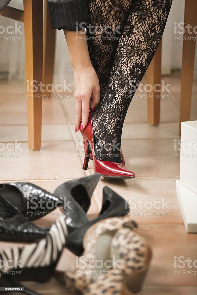 Trying on Red High Heel Shoes, Retail Fashion Boutique Close-up royalty-free stock photo