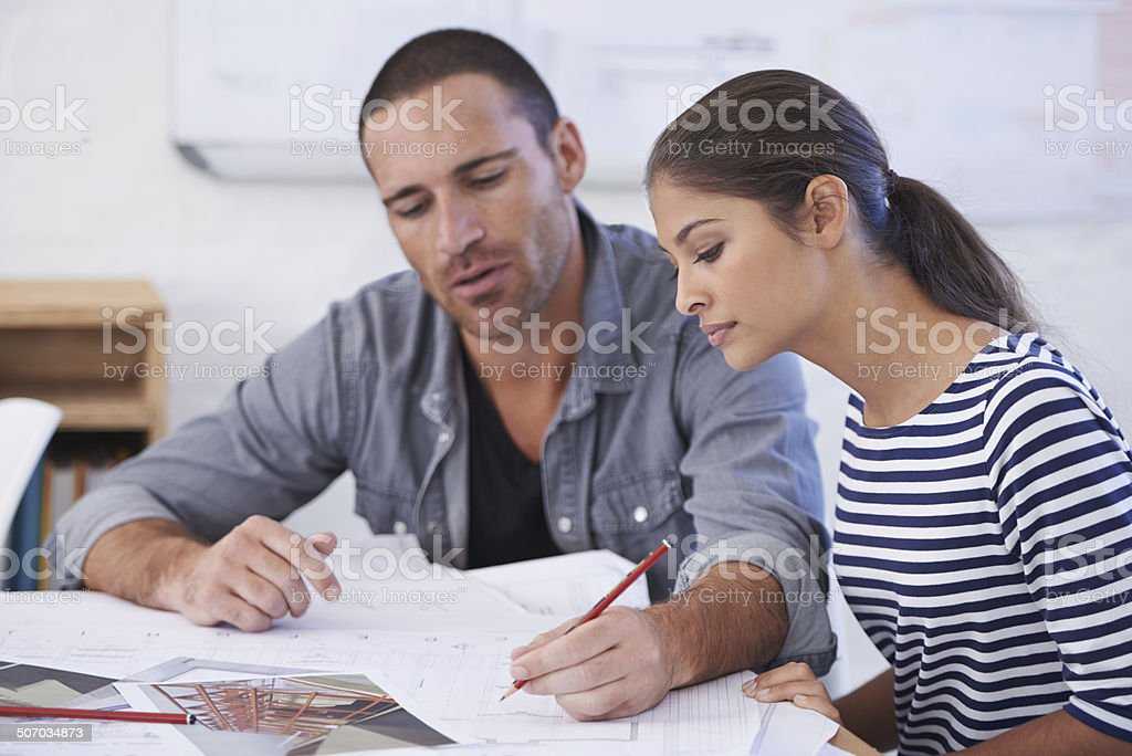 Trying to absorb all she can from his experienced eye royalty-free stock photo