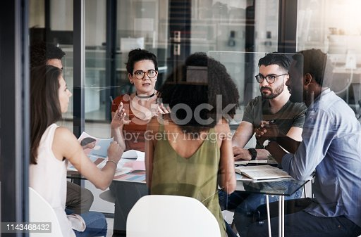 Shot of a group of designers having a meeting in an office