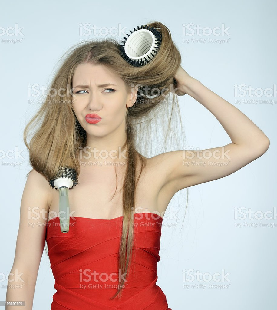 trying to brush her hair stock photo