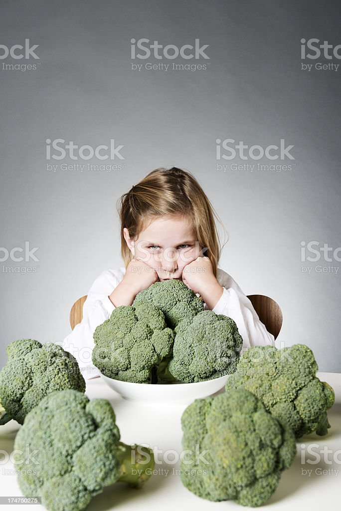 Trying To Get a Young Child To Eat Vegetables stock photo