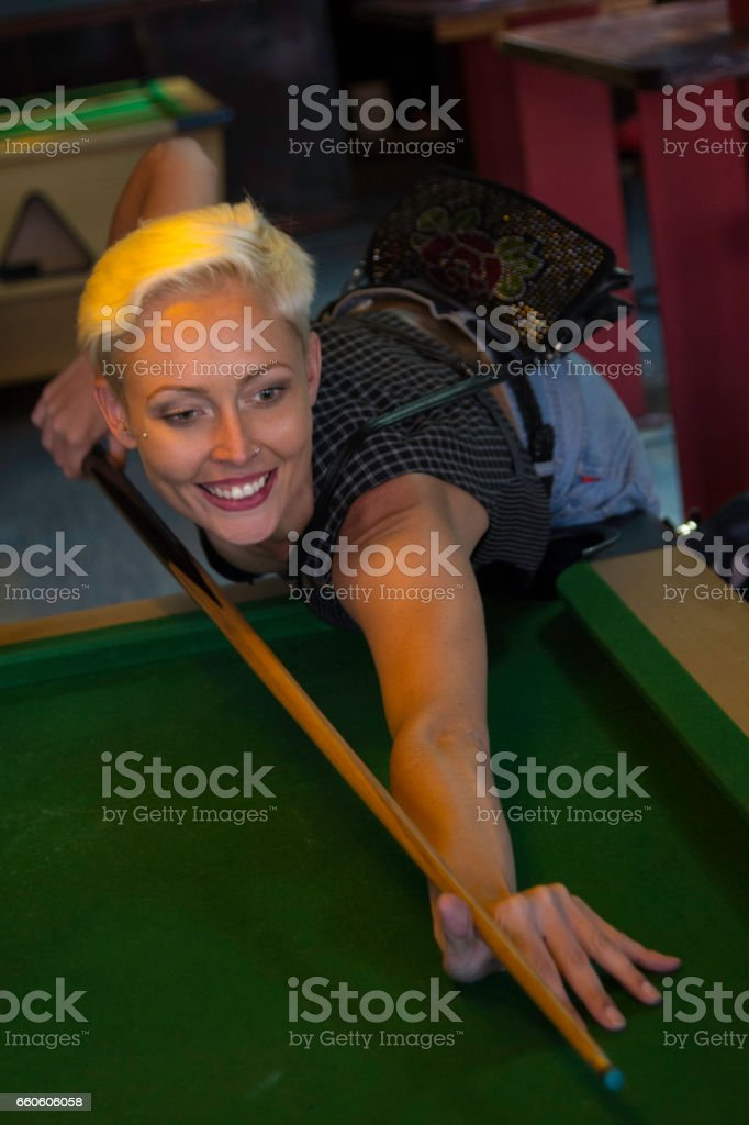 Trying to get the ball in the pocket royalty-free stock photo