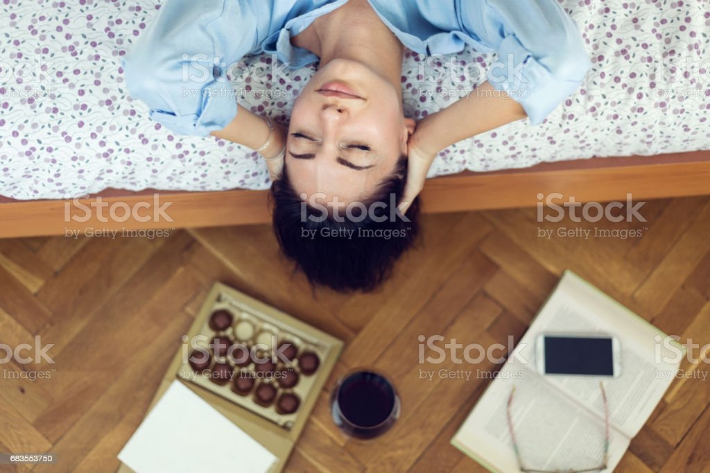 Trying to overcome the depression with wine and chocolate stock photo