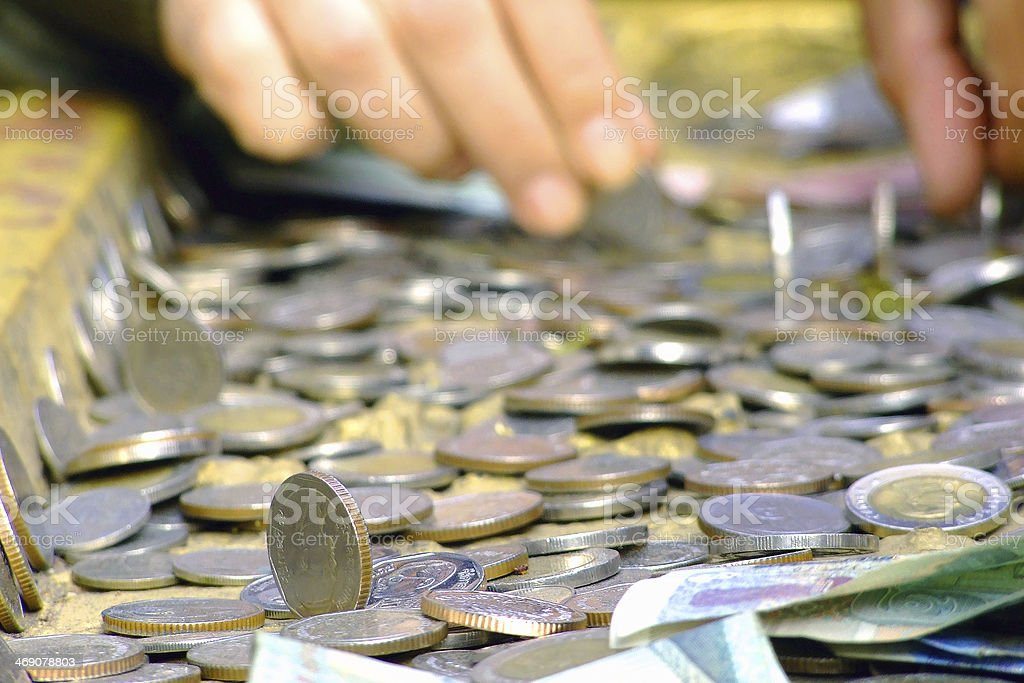 Trying to put the coins stock photo