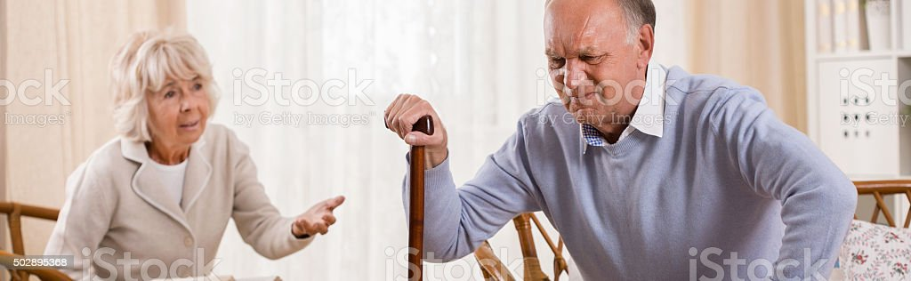 Trying to stand up stock photo