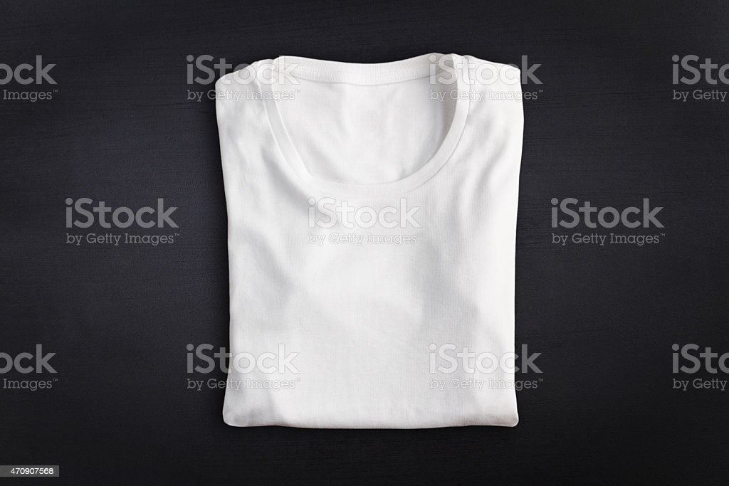 T-shirt against chalkboard background stock photo