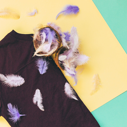 640200626 istock photo t-shirt and exotic coconuts with feathers 914751246