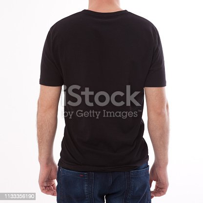 istock t-shirt design and people concept - close up of young man in blank black t-shirt, shirt front and rear isolated. 1133356190