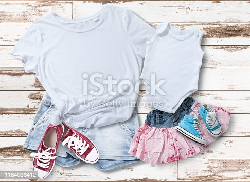 T-shirt design fashion concept, closeup of woman and baby in blank white t-shirt, shirt front isolated. Mock up for sublimation.