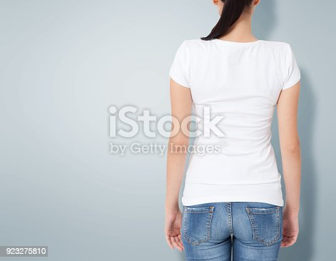 istock T-shirt design, people concept - closeup of young woman in blank white shirt, rear isolated. Mockup square. 923275810