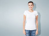 T-shirt design, people concept - closeup of young woman in blank white shirt, front isolated. Mockup square.