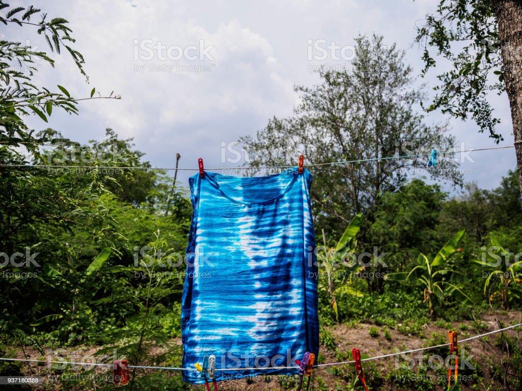 T-shirt handmade by tie dye fabric stock photo