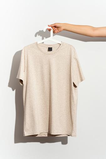 t-shirt mockup on wooden hanger