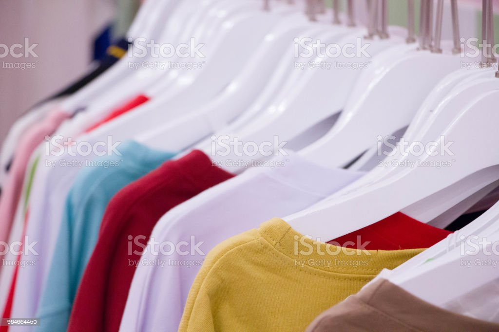 t-shirt on white wood hanger royalty-free stock photo