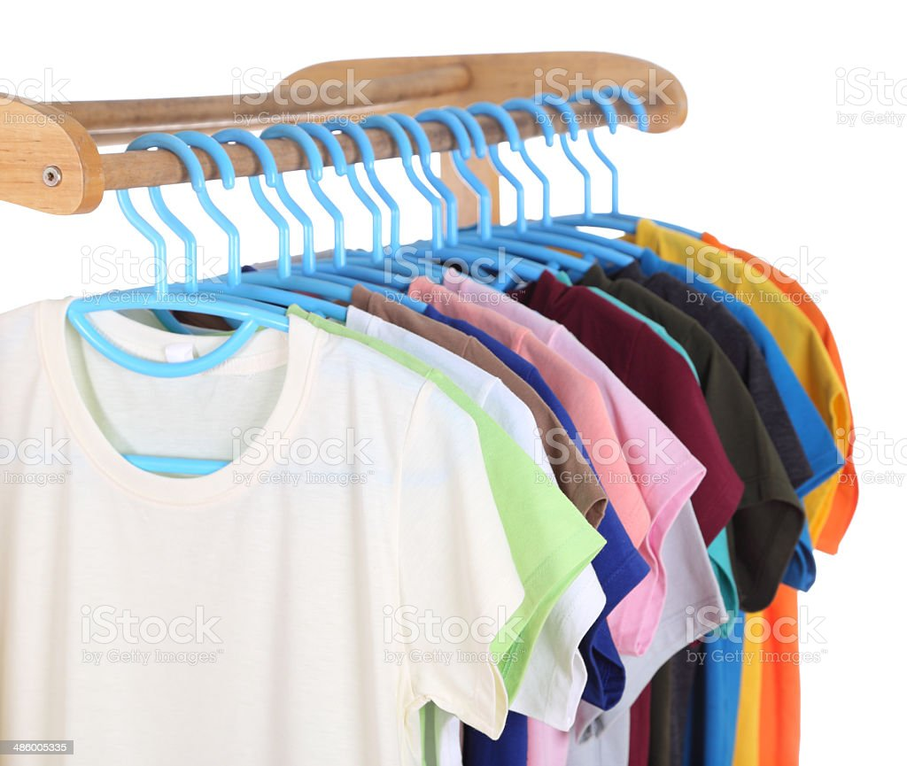 t-shirts hanging on hangers stock photo