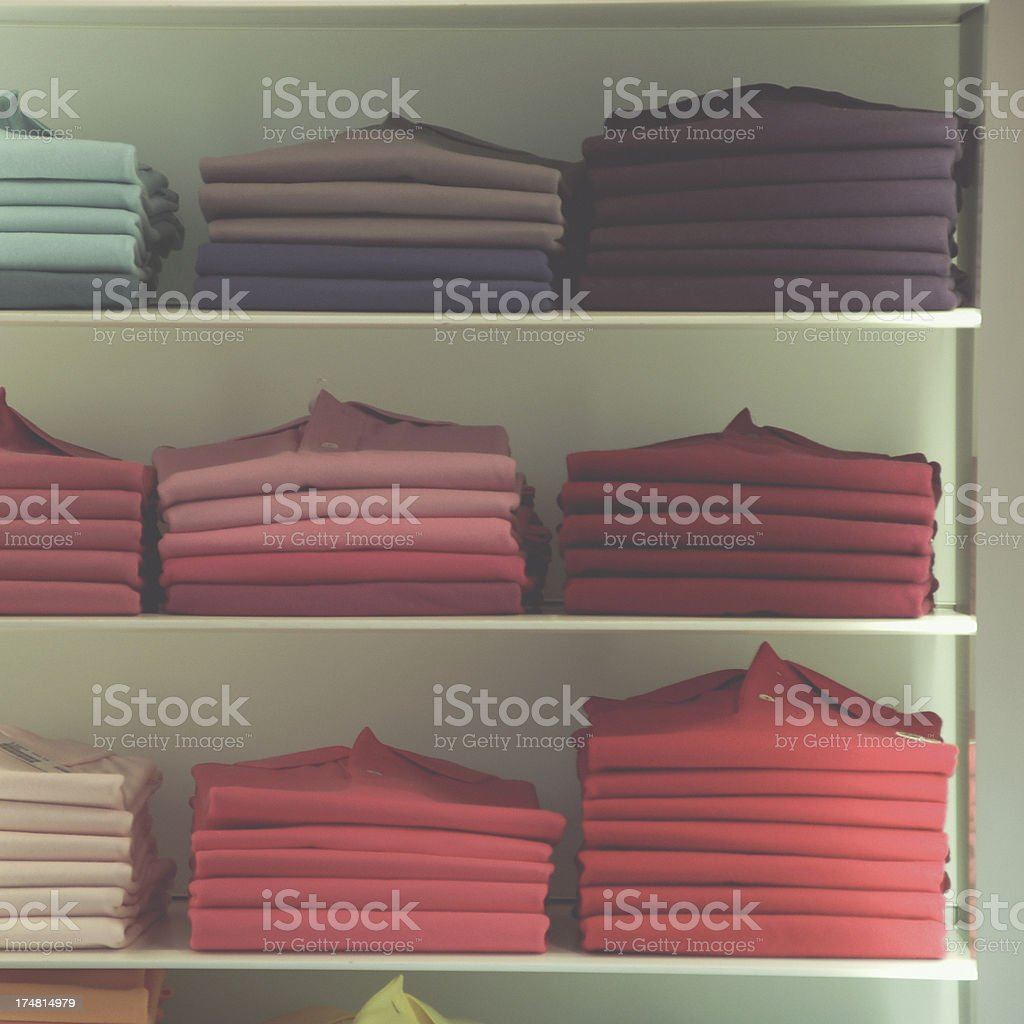 T-shirts in a shelf royalty-free stock photo