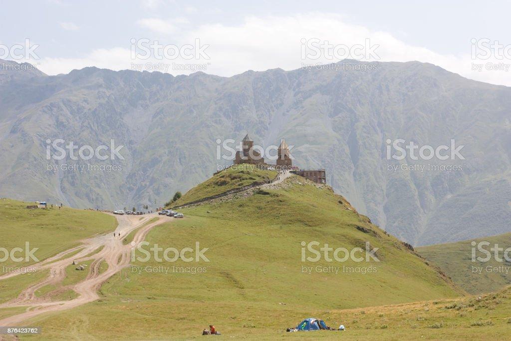 Tsminda Sameba- Holy Trinity Church near the Kazbegi-Gergeti village. stock photo