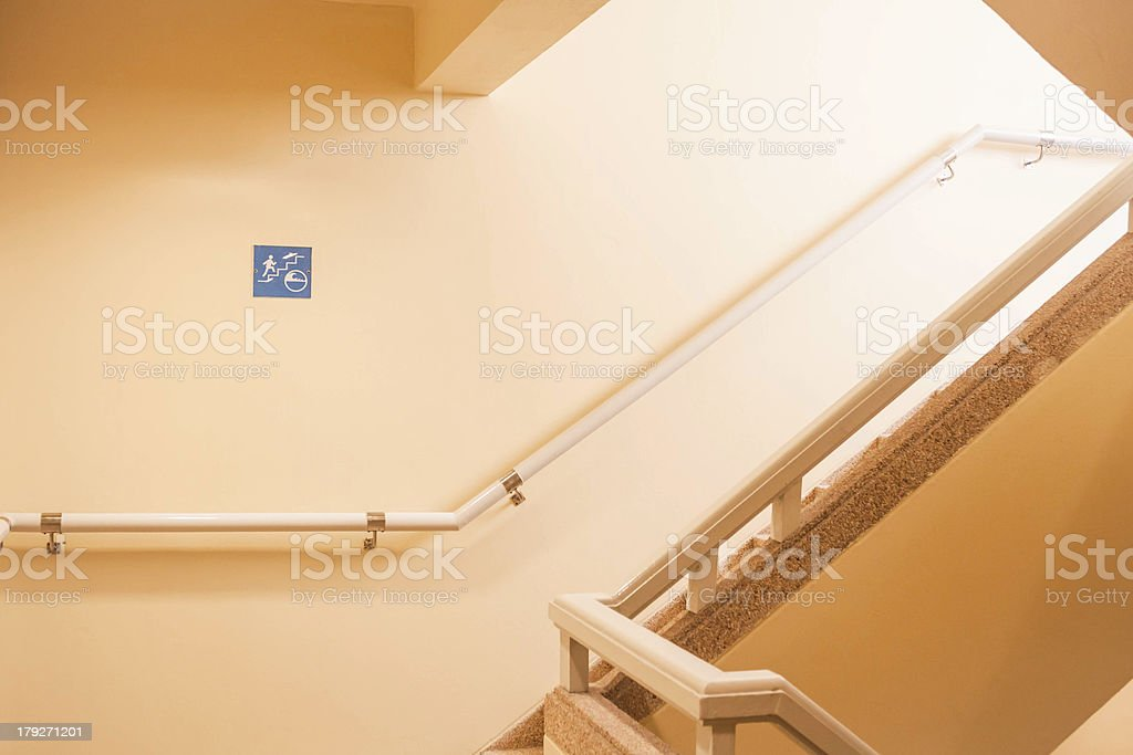 Tsunami escape stairwell behind a tall building royalty-free stock photo