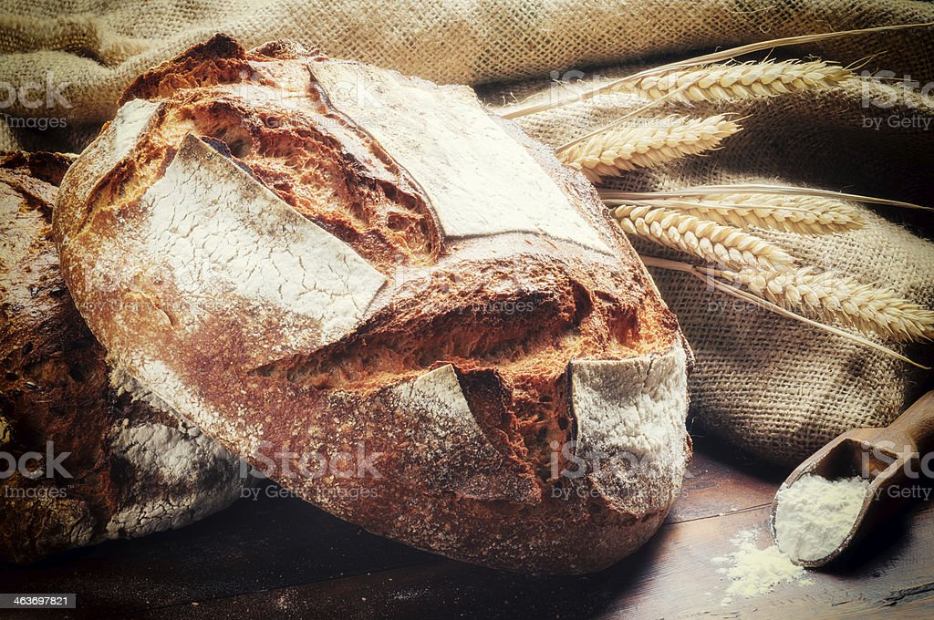 Ttraditional bread in rustic setting stock photo