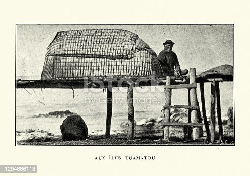 Vintage photograph of a Tuamotus man and hut on pier, Victorian 19th Century. The Tuamotus, also referred to in English as the Tuamotu Archipelago or the Tuamotu Islands (French: Îles Tuamotu, officially Archipel des Tuamotu), are a French Polynesian chain of almost 80 islands and atolls forming the largest chain of atolls in the world.
