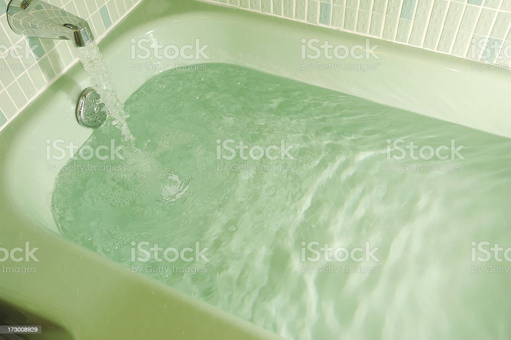 Tub filling up royalty-free stock photo