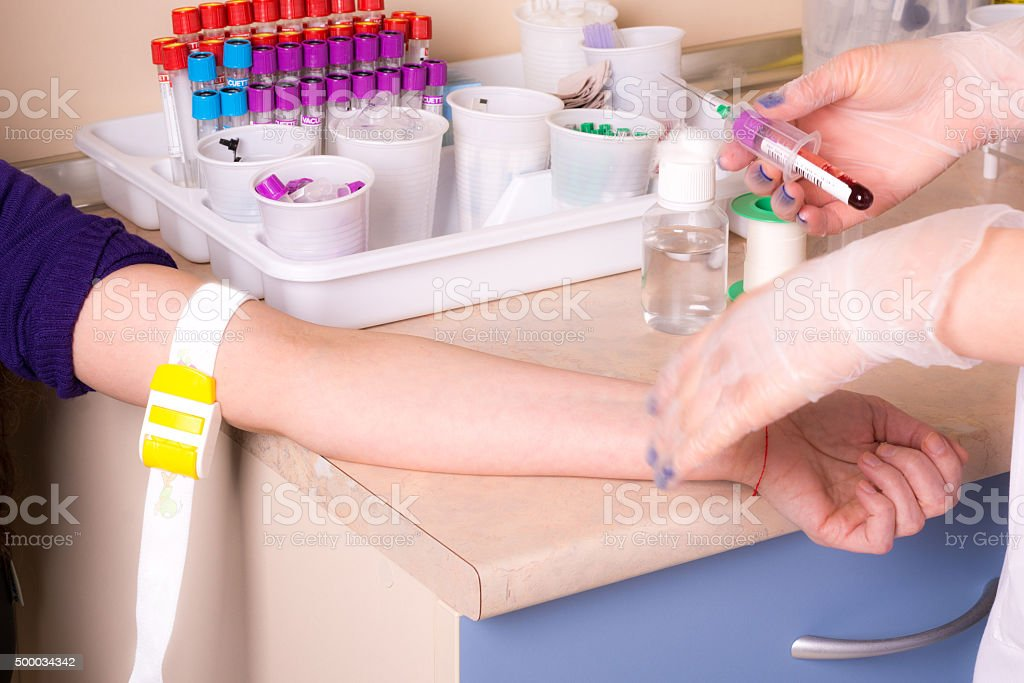 Tube and injection of blood tests stock photo