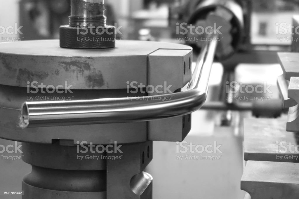 tube bending machine stock photo