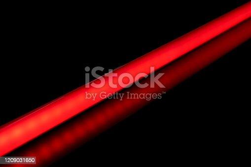 1029436214 istock photo LED tube light bulb red color. 1209031650