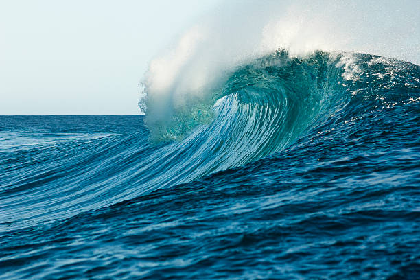 tube wave in formation at teahupoo beach - wave stock photos and pictures