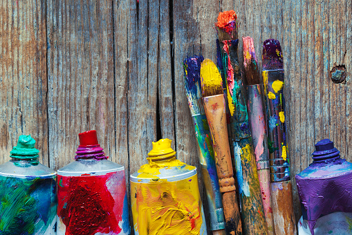 istock Tubes of oil paint and artist paint brushes closeup 514630316