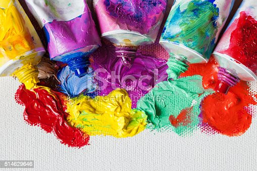 istock Tubes of oil paint and artist paintbrushes closeup on canvas 514629646