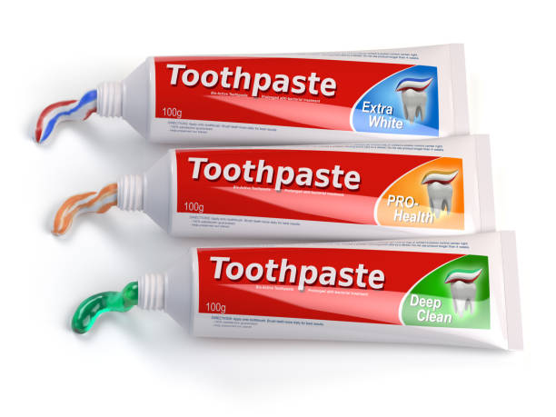 Tubes of toothpaste in different colors and differnt types of toothpaste stock photo