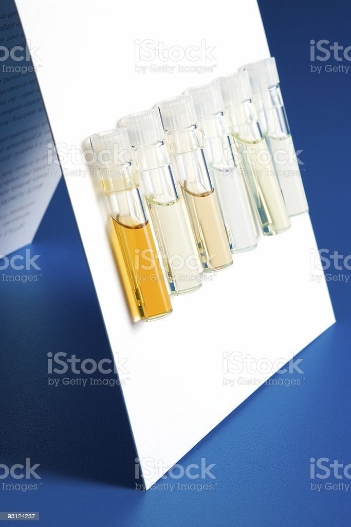 Tubes with samples on white cardboard stock photo